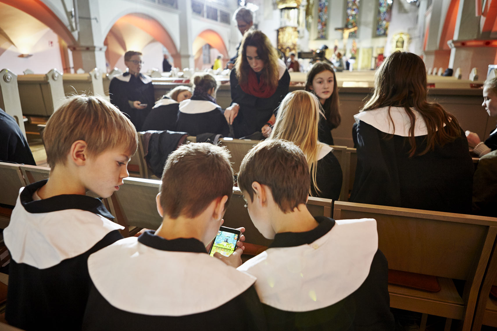 Choir boys playing video game, Georgenkirche