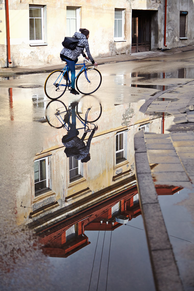 Cyclist and reflection in Uzupis