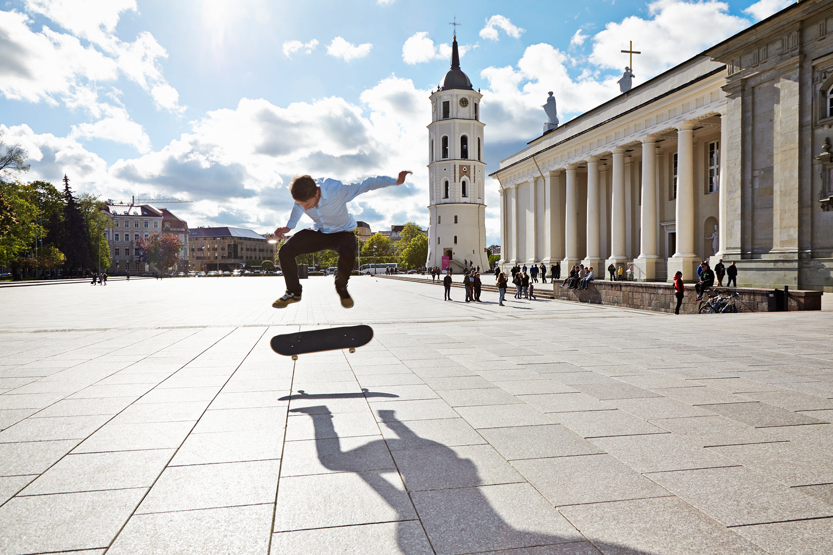 Skateboarder by cathedral