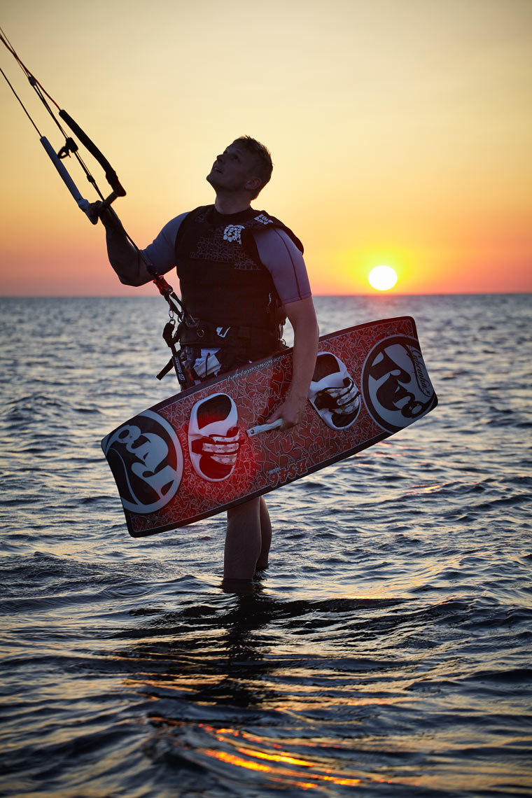 Wake boarder at sunset